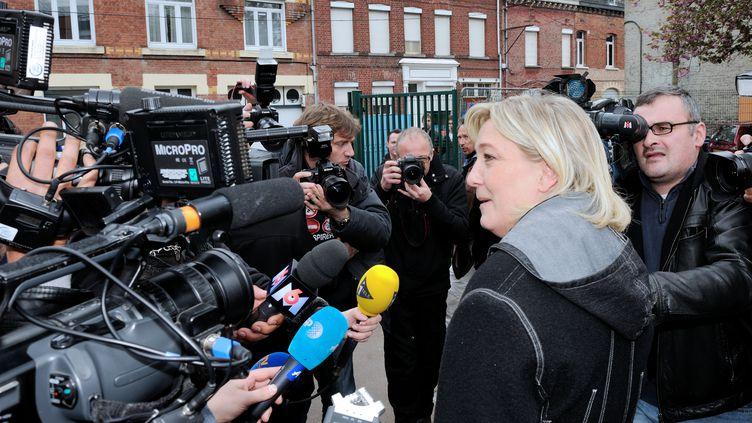 Marine Le Pen à la sortie de son bureau de vote à Hénin-Beaumont (Pas-de-Calais), le 6 mai 2012. (DENIS CHARLET / AFP)