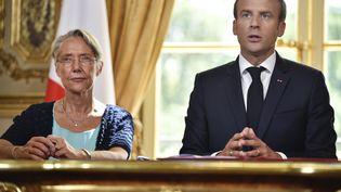 La ministre de la Transition écologique et solidaire, Elisabeth Borne, et le président de la République, Emmanuel Macron, le 27 juin 2018 à l'Elysée. (JULIEN DE ROSA / AFP)