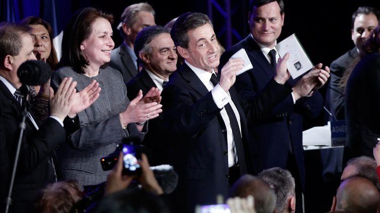 Le président de l'UMP, Nicolas Sarkozy, lors d'un meeting pour les élections départementales à Asnières (Hauts-de-Seine), le 24 mars 2015. (MAXPPP)