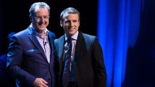 Richard Ferrand et Emmanuel Macron, le 9 février 2017 lors d'un meeting au théâtre Bobino à Paris. (MAXPPP)