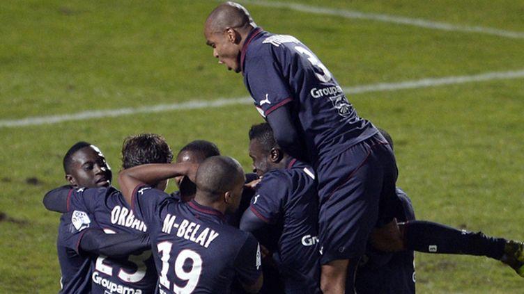 Hoarau félicité par ses camarades (JEAN PIERRE MULLER / AFP)
