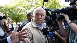 """Dominique Alderweireld, surnommé """"Dodo la Saumure"""", devant le tribunal de Lille, avant l'annonce du jugement dans l'affaire ditedu Carlton, vendredi 12 juin 2015. (PASCAL ROSSIGNOL / REUTERS)"""