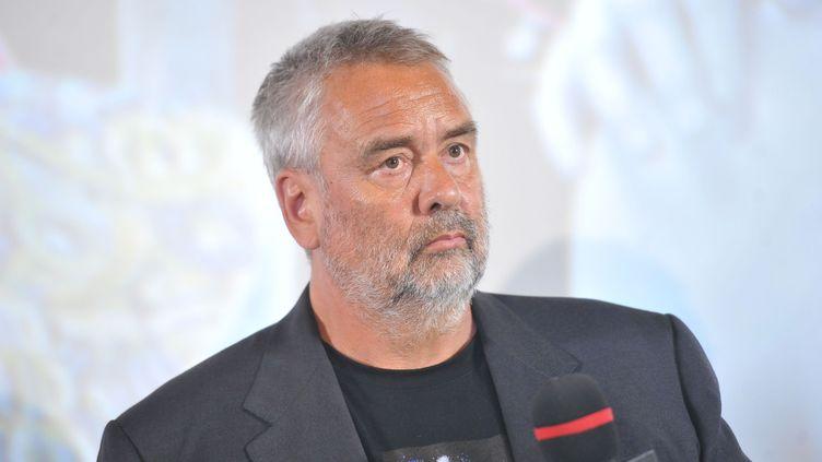 """Le réalisateur français Luc Besson, lors de la première du film """"Valérian et la cité des mille planètes"""" à Pékin (Chine), le 20 août 2017. (NIU DAQING / IMAGINECHINA / AFP)"""