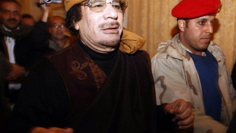 Mouammar Kadhafi à l'hôtel Rixos, le 8 mars 2011, à Tripoli. (AFP/MAHMUD TURKIA)