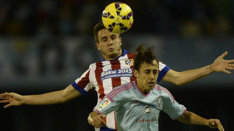Saul Niguez (Atlético Madrid) prend le dessus sur Fabian Orellana (Celta Vigo) (MIGUEL RIOPA / AFP)