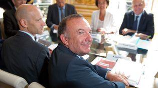 Pierre Gattaz a été reçu par le Premier ministre à Matignon, le 26 août 2013, dans le cadre des discussions sur la réforme des retraites. (LIONEL BONAVENTURE / AFP)