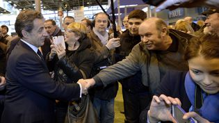 Nicolas Sarkozy, au salon de l'agriculture, le 25 février 2015. (MIGUEL MEDINA / AFP)