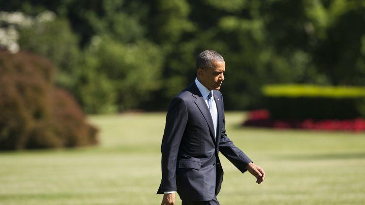 Le président américain, Barack Obama, sur les pelouses de la Maison blanche le 4 juin 2013 à Washington (Etats-Unis). (SAUL LOEB / AFP)
