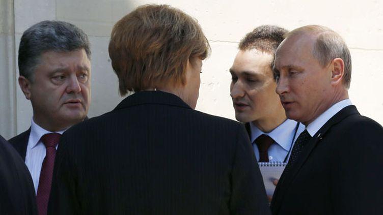 (Une première rencontre entre Vladimir Poutine et Petro Porochenko © Reuters | Kevin Lamarque)