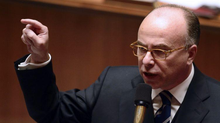 Le ministre délégué au Budget, Bernard Cazeneuve, le 15 octobre 2013, lors de la séance des questions au gouvernement, à l'Assemblée nationale, à Paris. (ERIC FEFERBERG/AFP)