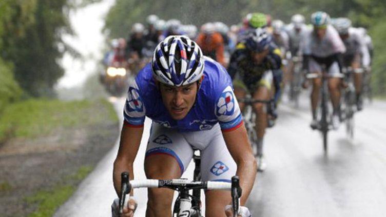 Jérémy Roy (FDJ) s'échappe sous la pluie (JOEL SAGET / AFP)