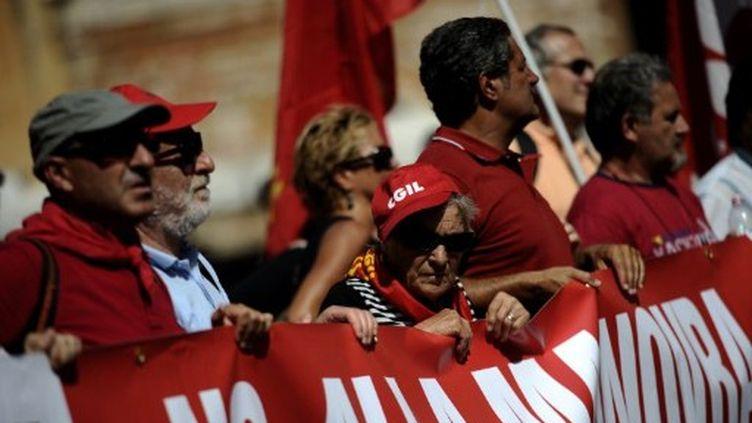 A Rome, les manifestants demandent au gouvernement italien de revoir sa copie sur le plan d'austérité (14/09/2011). (AFP/FILIPPO MONTEFORTE)
