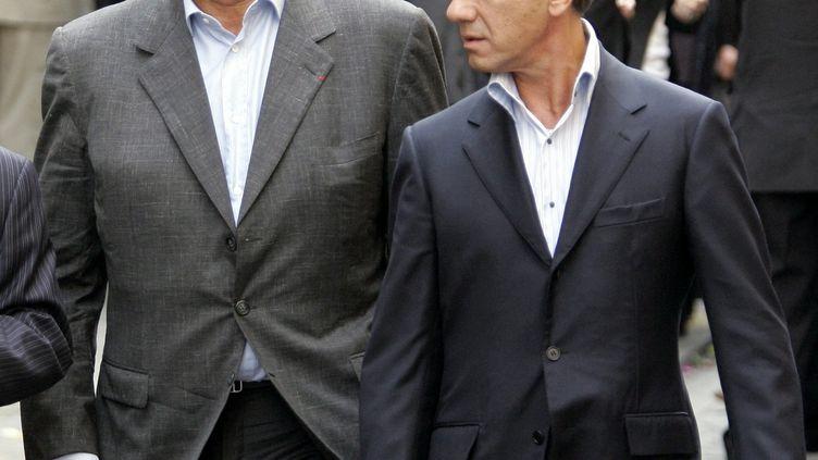Gérard Louvin et Daniel Moyne, le 4 juin 2007, lors de l'enterrement de Jean-Claude Brialy à Paris. (MAXPPP)