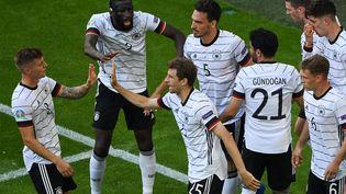 L'Allemagne fête son deuxième but face au Portugal. (MATTHIAS HANGST / POOL)