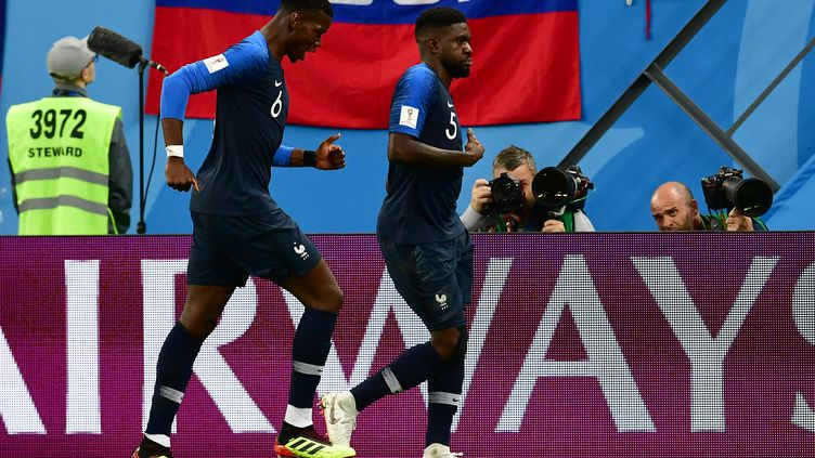 Umtiti et Pogba heureux (GIUSEPPE CACACE / AFP)