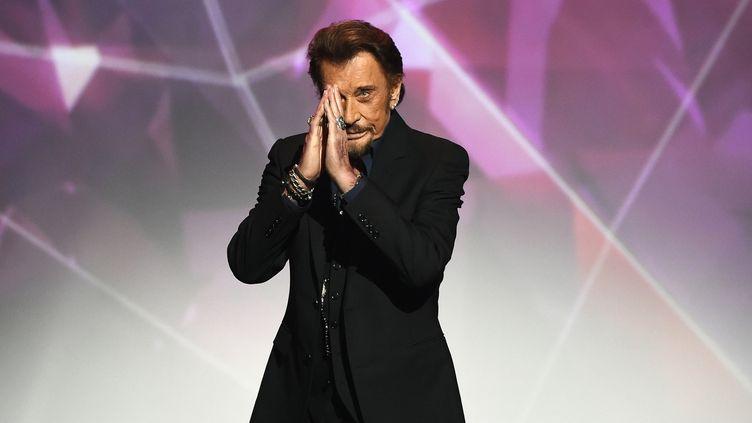 Johnny Hallyday lors de la cérémonie des 31e Victoires de la Musique au Zenith en 2016  (BERTRAND GUAY / AFP)
