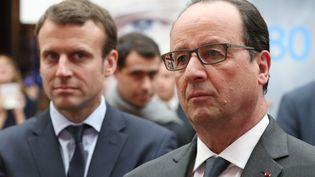 Le ministre de l'Economie, Emmanuel Macron, et François Hollande, le 23 mai 2016 au palais de l'Elysée à Paris. (CHARLES PLATIAU / AFP)