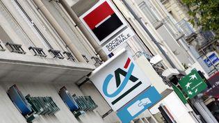 Les logos des trois banques françaises, Crédit Agricole, Société Générale et BNP Paribas. (DAMIEN MEYER / AFP)