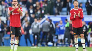 Les deux stars portugaises de Manchester United, Bruno Fernandes et Cristiano Ronaldo. (PAUL ELLIS / AFP)