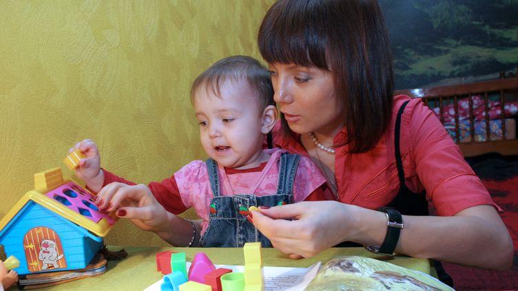 Svetlana Izambayeva, une mère séropositive, dirige une ONG de lutte contre le sida à Kazan (Russie). (MAKSIM BOGODVID / RIA NOVOSTI)