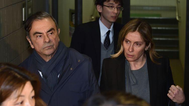 Carlos et Carole Ghosn, à Tokyo, le 3 avril 2019. (KAZUHIRO NOGI / AFP)