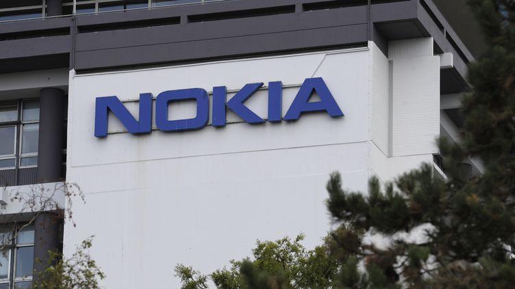 En France, la filiale de Nokia concernée a déjà été visée par deux plans de restructuration ces dernières années. (THOMAS SAMSON / AFP)