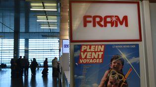 Une publicité du groupe Fram, à l'aéroport de Toulouse-Blagnac (Haute-Garonne), le 22 octobre 2015. (ERIC CABANIS / AFP)