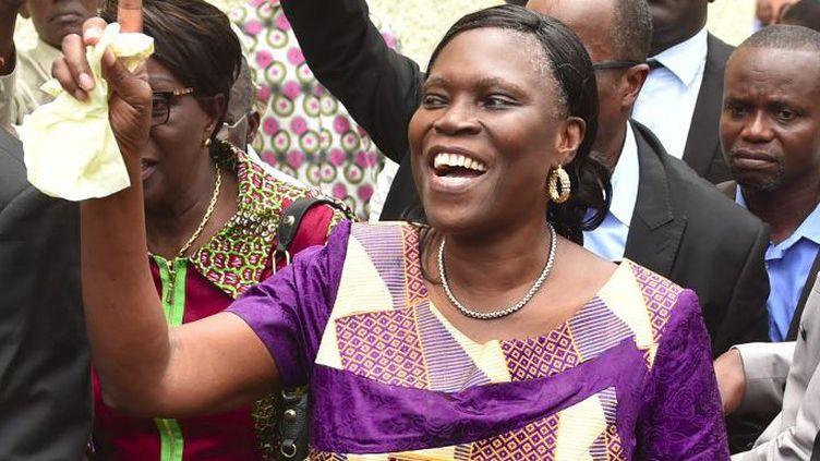 Le retour triompal de Simone Gbagbo à son domicile d'Abidjan. L'ex-première dame a été libérée le 8 août 2018 après 7 ans de prison. (Photo AFP/Issouf Sanogo)
