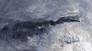 Image satellite d'un pétrolier en feu dans le Golfe d'Oman, près du détroie d'Hormuz, le 13 juin 2019. (GALLO IMAGES / GALLO IMAGES EDITORIAL)