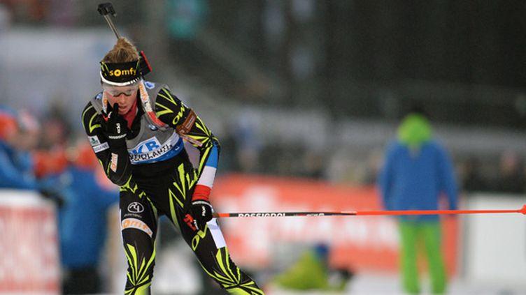 Marie Dorin a offert la médaille d'argent au relais féminin français (RALF HIRSCHBERGER / DPA)