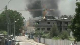 Explosion d'un dépôt de munitions militaires à Brazzaville (Congo), le 4 mars 2012 (capture d'écran). (FRANCE 2)