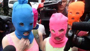 Les deux Pussy Riot, le 18 février 2014 à Sotchi.  (Andrej Isakovic / AFP)