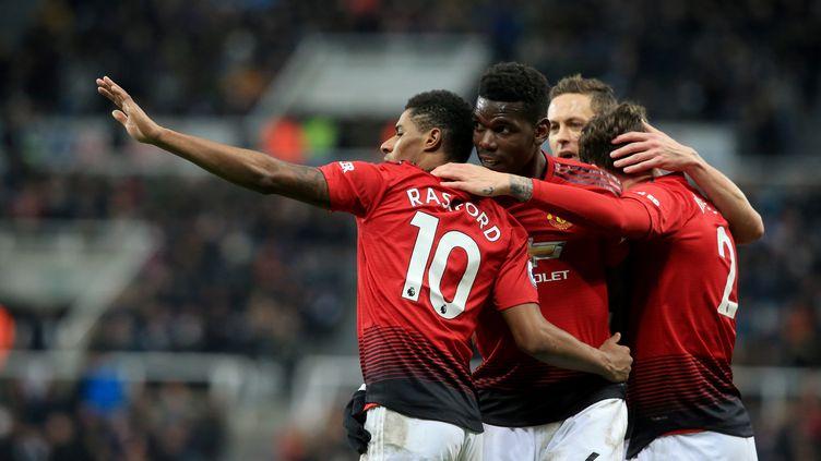 Manchester United a enchaîné une quatrième victoire de rang en s'imposant à Newcastle (LINDSEY PARNABY / AFP)