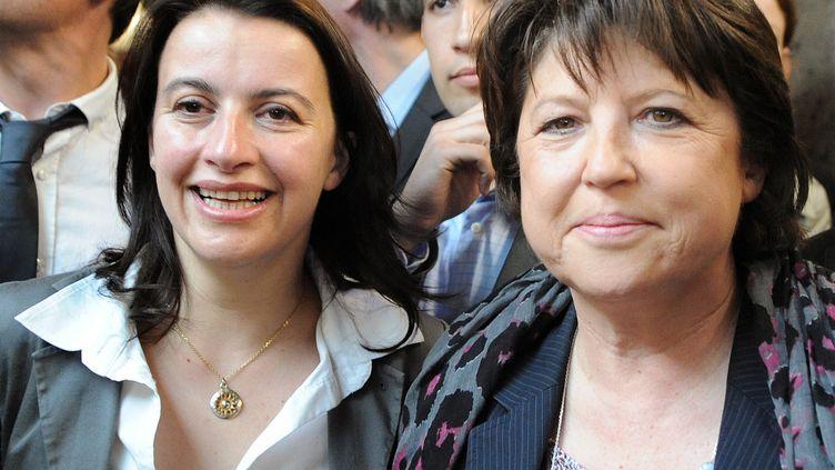 """Cécile Duflot (à gauche) etMartine Aubry ont validé, mardi 15 novembre, un """"accord politique"""" entre le Parti socialiste et Europe écologie - Les Verts. (JEAN-FRANCOIS MONIER / AFP)"""