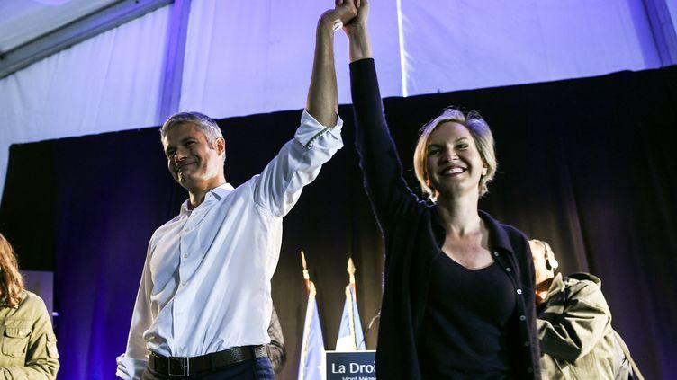 Le président du parti Les Républicains Laurent Wauquiez, aux côtés de Virginie Calmels, ex-numéro 2 du parti, le 3 septembre 2017 en Haute-Loire. (PHILIPPE DESMAZES / AFP)