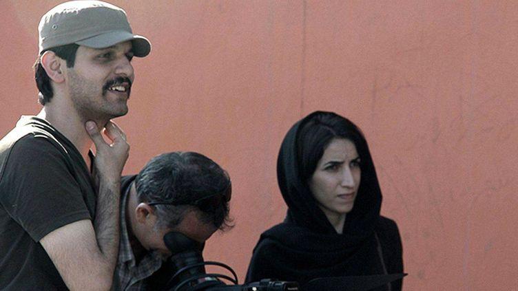 """Keywan Karimi, son cadreur Arasto Givi et l'assistante de réalisation Fateme Hafezi sur le tournage du documentaire """"Écrire sur la ville"""", tourné entre 2012 et 2015  (Non crédité / AP / Sipa)"""