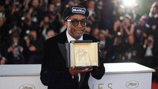 """le réalisateur américain Spike Lee à son grand prix du 71e Festival de Cannes pour""""BlacKkKlansman"""", en 2018. (LOIC VENANCE / AFP)"""