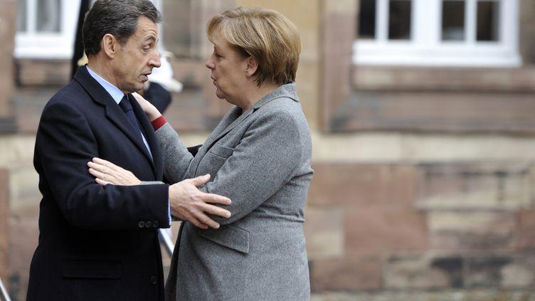 Nicolas Sarkozy et la chancelière allemande Angela Merkel, à Strasbourg le 24 novembre 2011. (ERIC FEFERBERG / AFP)