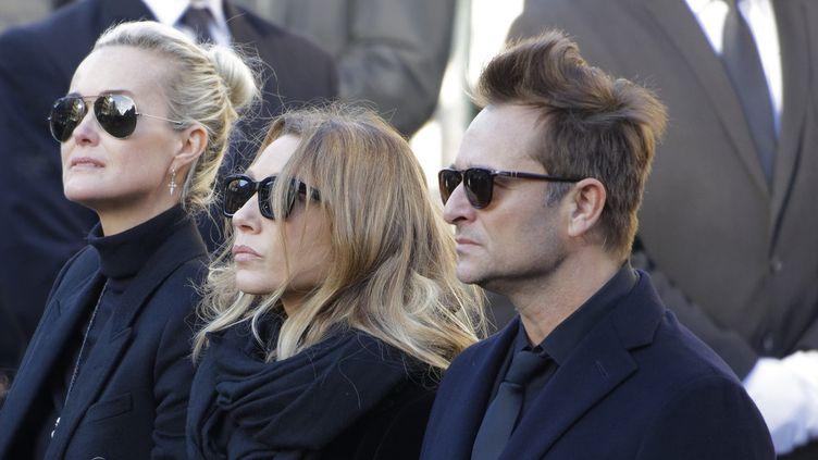 Laeticia Hallyday , Laura Smet et David Hallyday lors des obsèques de Johnny  (Bernard MANIGAULT / AFP)
