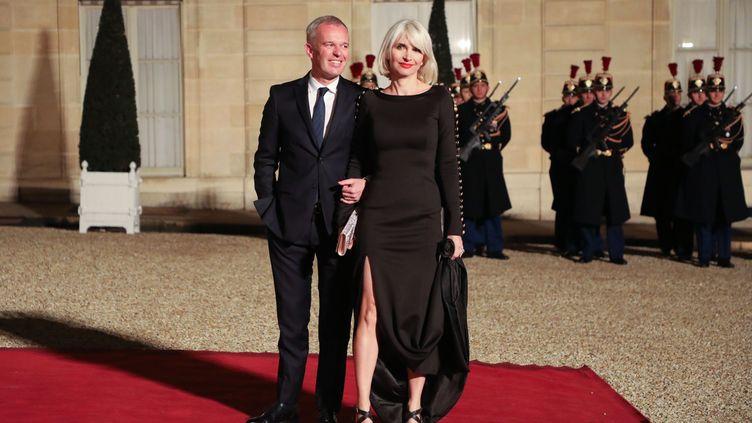 Le ministre de la Transition écologique, François de Rugy, et son épouseSéverine Servat-de Rugy, le 19 mars 2018 à l'Elysée. (LUDOVIC MARIN / AFP)