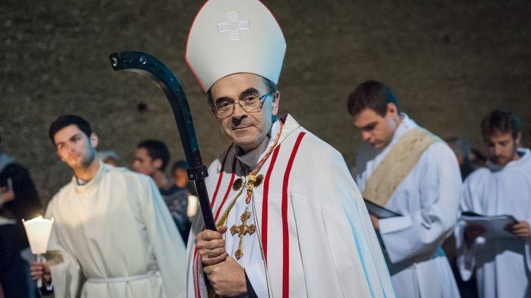 Le cardinal Philippe Barbarin mène une procession à Lyon, le 8 décembre 2015. (FRANCK CHAPOLARD / CITIZENSIDE / AFP)
