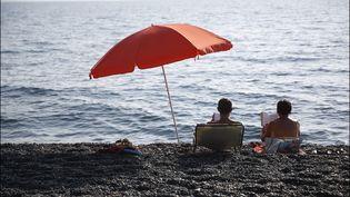 Couplez sur une palge du Cap Corse, juillet 2015 (LUC NOBOUT / MAXPPP)