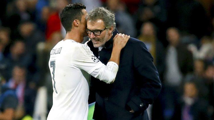 Cristiano Ronaldo et Laurent Blanc. (JUANJO MARTIN / EFE)
