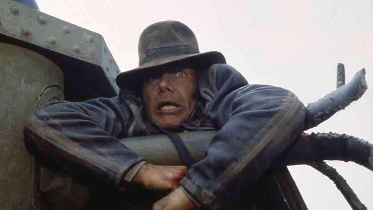 """Harrison Ford et son chapeau dans le rôle d'Indiana Jones, dans le premier film de la saga, """"Les Aventuriers de l'Arche perdue"""", sorti en 1981. (MAXPPP)"""