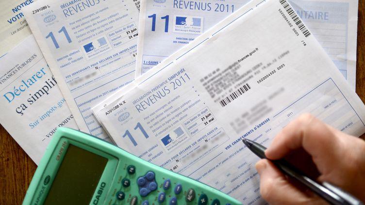 La loi de finances rectificative discutée à l'Assemblée nationale va modifier parfois grandement le montant de l'impôt acquitté par les foyers. (PATRICK HERTZOG / AFP)
