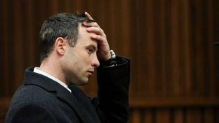 L'athlète Oscar Pistorius lors d'une audience de son procès, le 8 juillet 2014, à Pretoria (Afrique du Sud). (SIPHIWE SIBEKO / AP / SIPA)