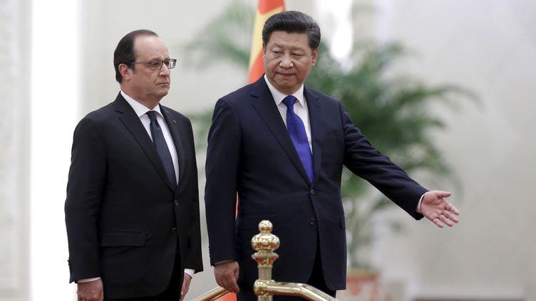 Les présidents français et chinois, François Hollande et Xi Jinping, le 2 novembre 2015 à Pékin (Chine). (JASON LEE / REUTERS)