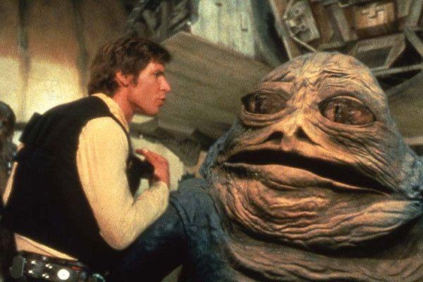 """Harrison Ford et Jabba the Hutt dans """"Star Wars : Episode IV - Un nouvel espoir"""" (""""La Guerre des étoiles"""") de George Lucas. (Waltd Disney France)"""