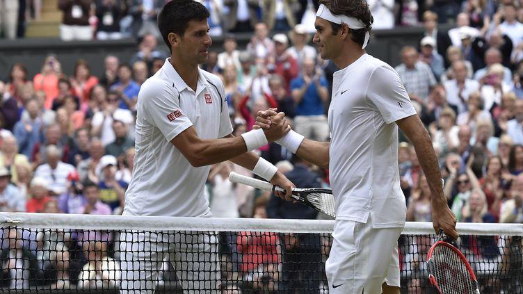 Djokovic-Federer, une rivalité qui n'est pas près de s'arrêter. (TOBY MELVILLE / POOL)