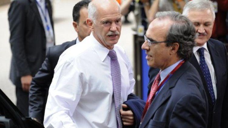 Le 1er ministre grec, George Papandreou (G) au sommet de l'UE le 21 Juillet 2010 à Bruxelles (AFP PHOTO / JEAN THYS)